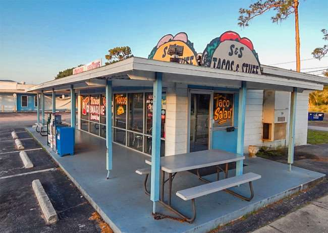 MAY 17, 2015 - Outside bench seating at Marian's Submarine restaurant on College Ave and US-41, Ruskin South Shore, FL