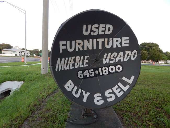 MAY 18, 2015 - A sign made from old parabolic satellite dish for Used Furniture Mueble Usado, 645-1800