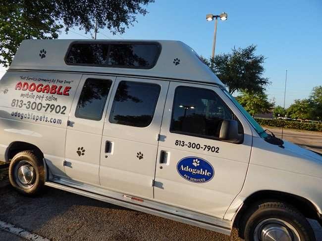 MAY 18, 2015 - Adogable Mobile Pet Grooming van in Kings Crossing, Sun City Cente, FL