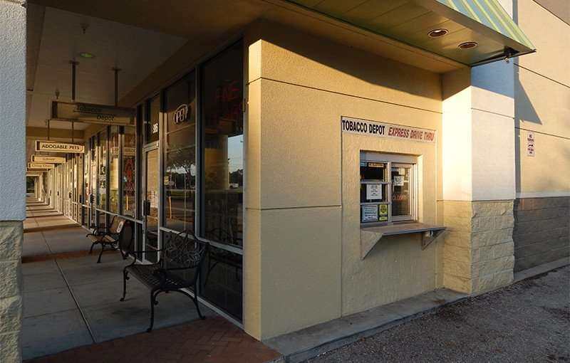 MAY 18, 2015 - Drive-thru window for cigarettes at Tobacco Depot in retirement community in Sun City Center, FL