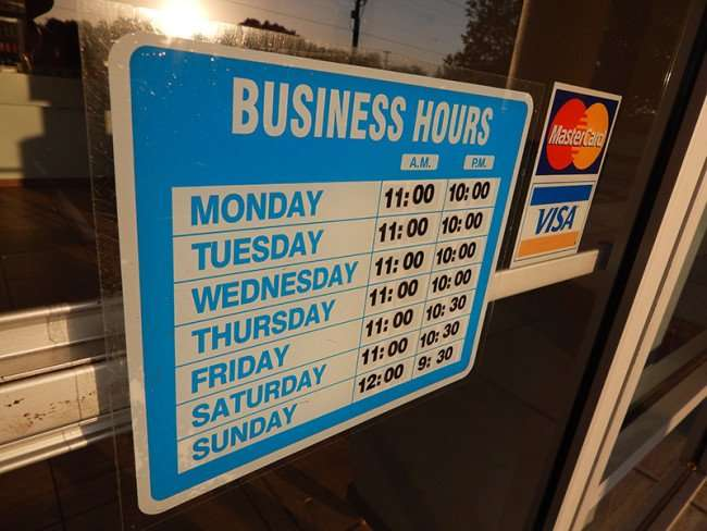MAY 18, 2015 - Hours on door at China Chen Chinese restaurant in Kings Crossing, Sun City Center, FL