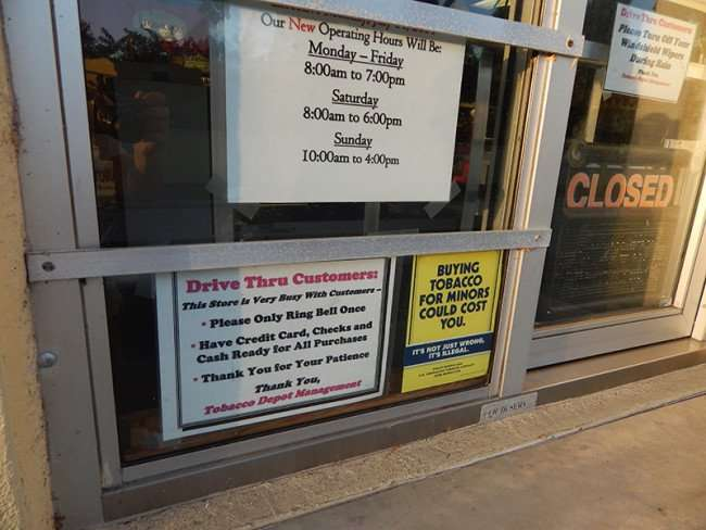 MAY 18, 2015 - Hours on drive-thru window at Tobacoo Depot in retirement community of Sun City Center, FL