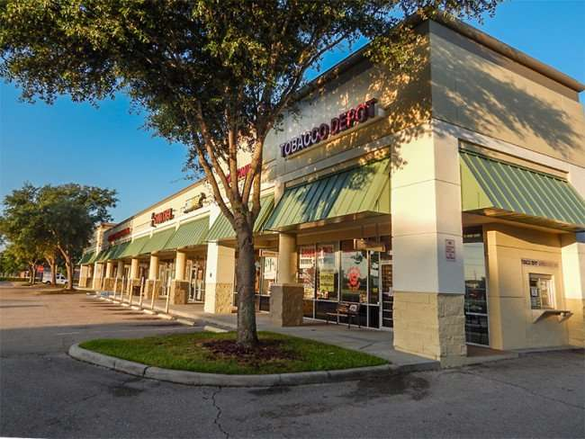 MAY 18, 2015 - Tobacco Depot with drive-thru in retirement community in Kings Crossing shopping center, Sun City Center, FL