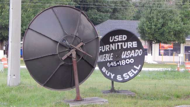 MAY 20, 2015 - Old satellite dish atennas used for new marketing signs in Ruskin South Shore, FL