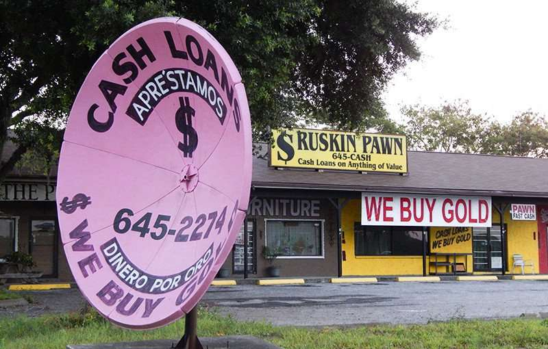 MAY 20, 2015 - Pink satellite dish atenna used for advertising sign for Ruskin Pawn, South Shore, FL