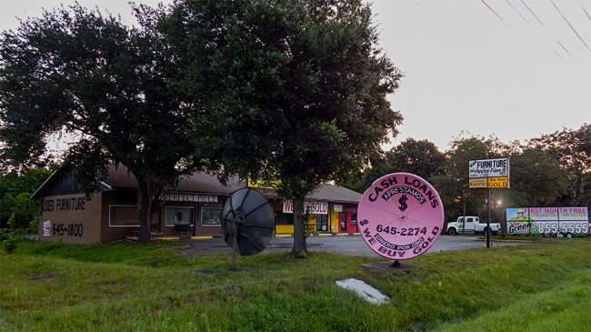 MAY 20, 2015 - Satellite dish atenna used for clever marketing in Ruskin South Shore, FL