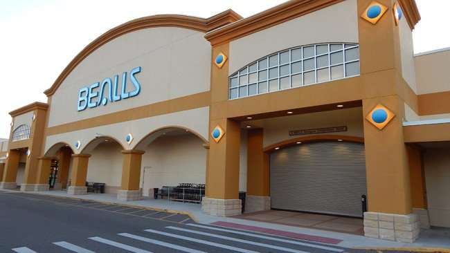 MAY 9, 2015 Bealls department store in Cypress Village strip mall with wooden fenced area across the parking lot/ 2015 Photo News 247