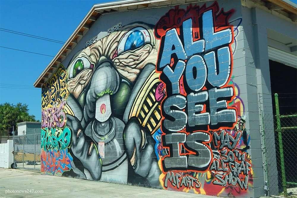 MF Arts monster mural on building in Ybor City Tampa, FL