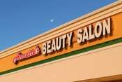 May 7, 2015: Moon above new sign installed April 20th at Annett's Beauty Salon in Sun City Center Plaza/photonews247.com