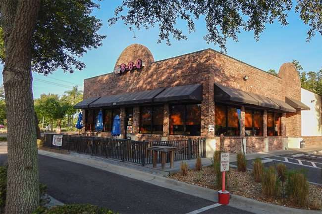 May 2015 - Parking lot for golf carts at Bubbaques BBQ, Sun City Center-Ruskin, FL/photonews247.com