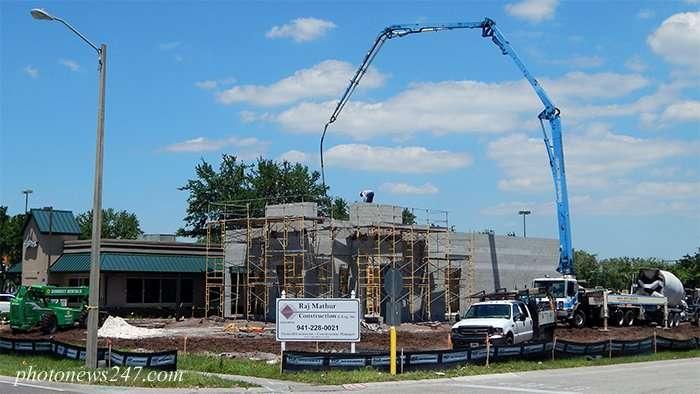 Telescopic boom pumps concrete into Dunkin Donuts building in Sun City Center, South Shore, FL