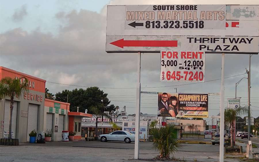 Thriftway Plaza sign South Shore Mixed Martial Arts and Champions Life International Church