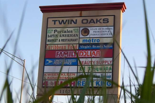 MAY 12, 2015: Twin Oaks plaza sign at strip-mall on Us Hwy 41, Gibsonton South Shore, FL / Photo News 247