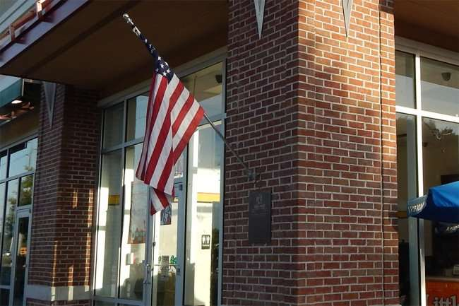 May 2015: US Flag Little Caesars Pizza, Cypress Village, Sun City Center Blvd, Ruskin, FL/2015 photonews247.com