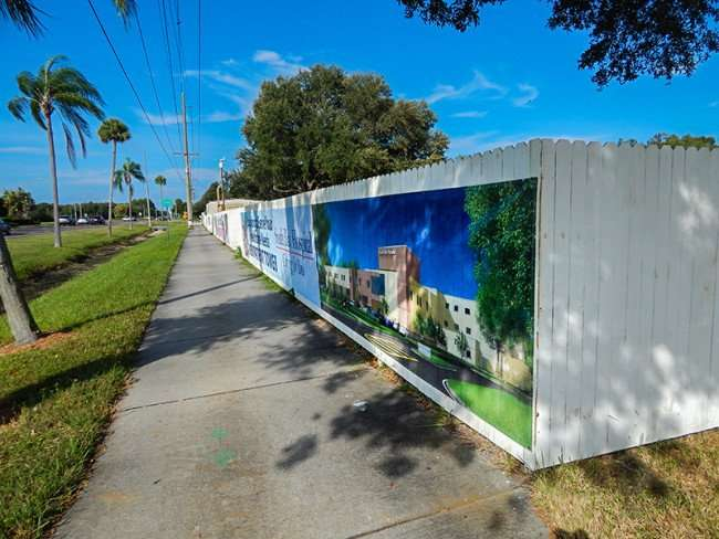 OCT 31, 2015 - Fence along sidewalk at construction site New Patient Tower, South Bay Hospital, Sun City Center FL/photonews247.com