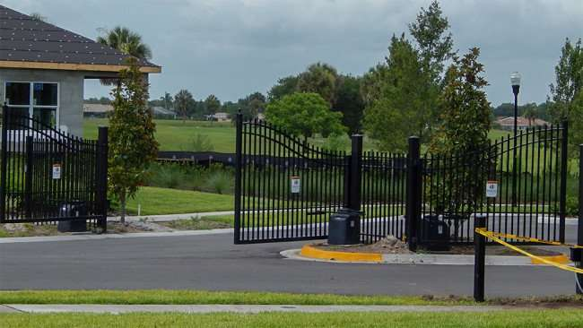 JUNE 12, 2015 - Electric gates on Chipper Drive at Verona 55+ community, Sun City Center, FL