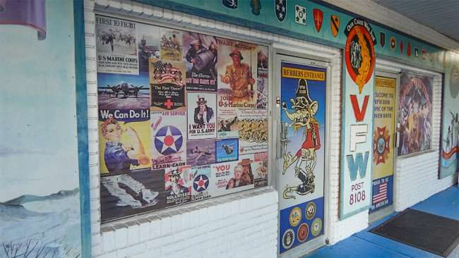 June 10, 2015 - Amy, Navy and Marine War poster on window at Riverview Memorial VFW Post 8180