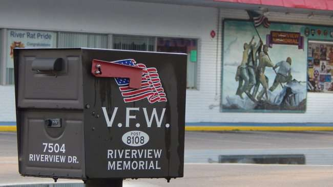 June 10, 2015 - Mailbox with soldiers raising flag in mural painting at Riverview Memorial VFW 8108, Riverview, FL