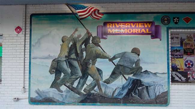 June 10, 2015 - Soldier raising flag on painted mural at Riverview Memorial VFW Post 8108