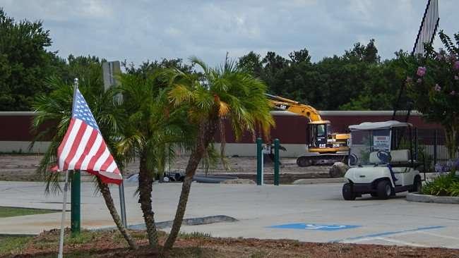 June 12, 2015 - Catepiller digger excavating land at at Champion Self Storage in Ruskin, FL