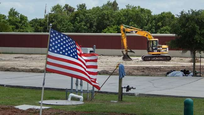 June 12, 2015 - Catepiller digger parked after excavating land at Champion Self Storage in Ruskin, FL
