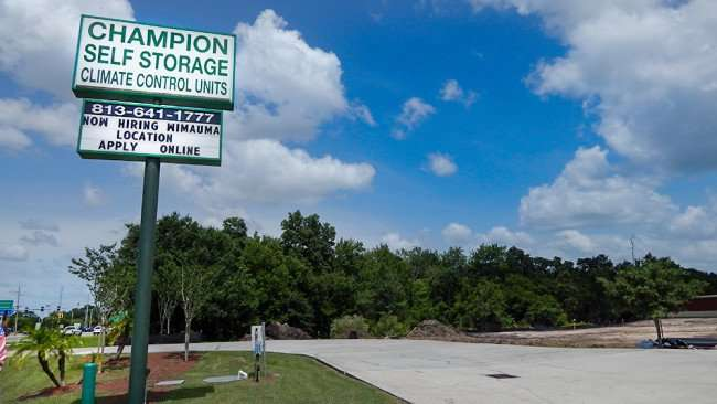 June 12, 2015 - Sign in Ruskin reads Hiring at Champion Self Storage in Wimauma, FL