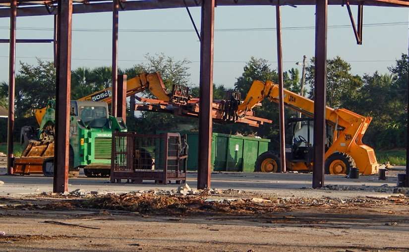 June 15, 2015 - JCB and Yellow 506c tractors life i-beams into bin in South Shore, South Bay FL