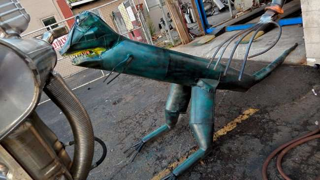 June 17, 2015 - dinosaur created by famous metal artist Mark McElwain from the Tampa Bay Florida and St. Petersburg region
