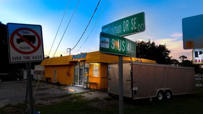 June 20, 2015 - Wild Bill's Furniture Store with side walk a few feet away from US 41 in Ruskin, FL