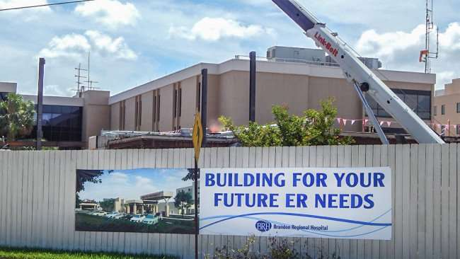 June 23, 2015 - JE Dunn Construction sign Construction Area, Hard Hat and Eye Protection Required Brandon Regional Hospital