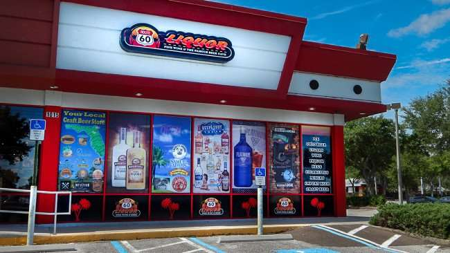 June 23, 2015 - Route 60 Liquor Store with colorful tinted window graphics in brandon, FL