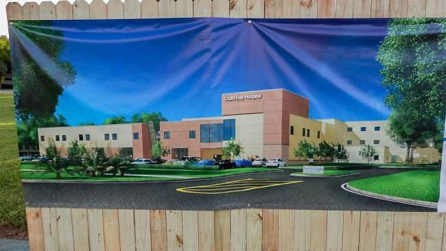 June 27, 2015 - Rendering on banner by CPPI Construction of Patient Tower at South Bay Hospital