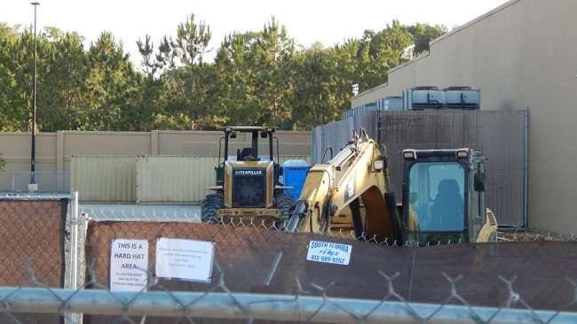 June 7, 2015 - Excavators inside fenced area of new liquor store at Walmart Brandon, Florida