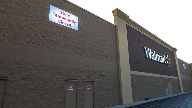 June 7, 2015 - Sign STORE TEMPORARILY CLOSED hangs on Brandon Walmart Supercenter for plumbing problems and new liquor store addition