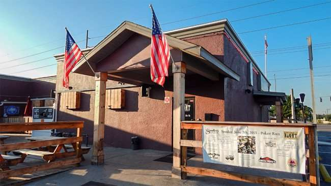 June 7, 2015 - US Flags fly proudly in back patio at One Night Stand Bar and Grill, Valrico, FL