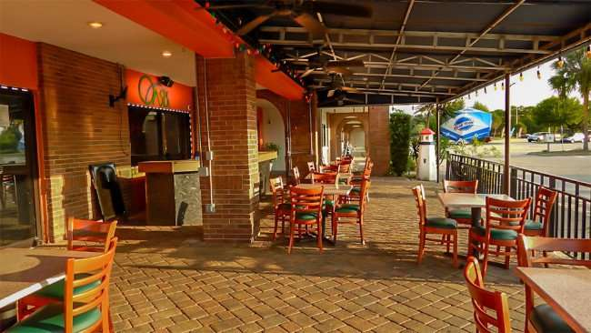MAY 22, 2015 - Oasis Restaurant outside patio dining area in Apollo Beach, FL