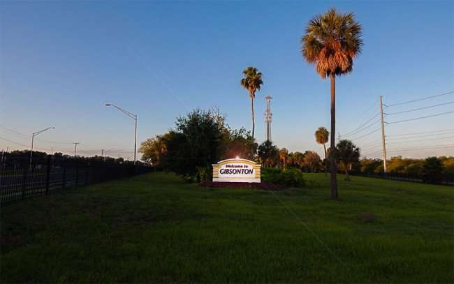 MAY 31, 2015 - Welcome to Gibsonton sign with light added on top as example