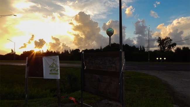 Apollo Beach Water Tower from Winn-Dixie parking lot across US Hwy 41 SouthShore, FL/photonews247.com