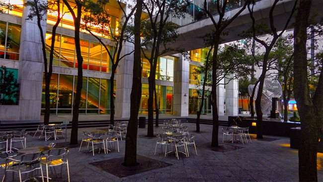 AUG 9, 2015 - Bank of America Plaza court yard with tables and chairs, Downtown Tampa, FL/photonews247.com