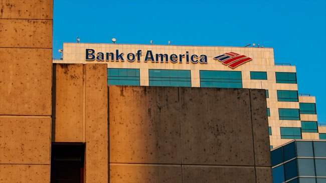 AUG 9, 2015 - Bank of American logo on top of skyscraper over Municipal Office building seen from Florida Ave, Tampa, FL/photonews247.com