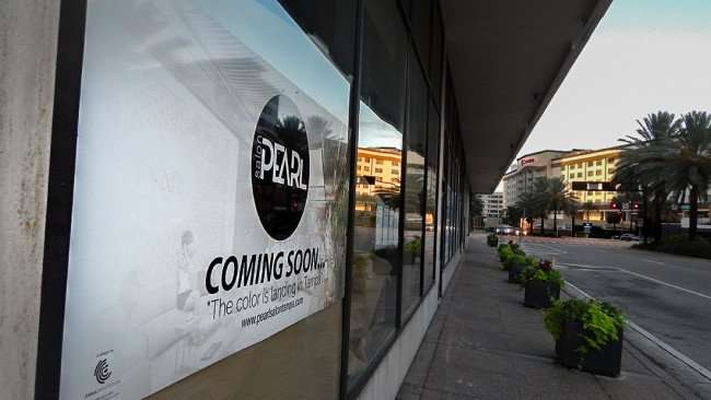 JULY 26, 2015 - Banner in window on Ashley that reads coming soon Pearl Salon Tampa/photonews247.com