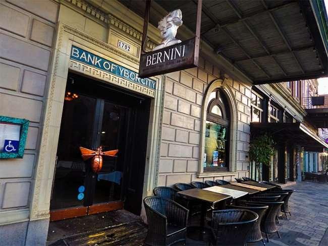 NOV 8, 2015 - Bernini Italian Restaurant in Bank Of Ybor City building embossed on front door entrance on 7th Ave, Ybor City Tampa, FL/photonews247.com