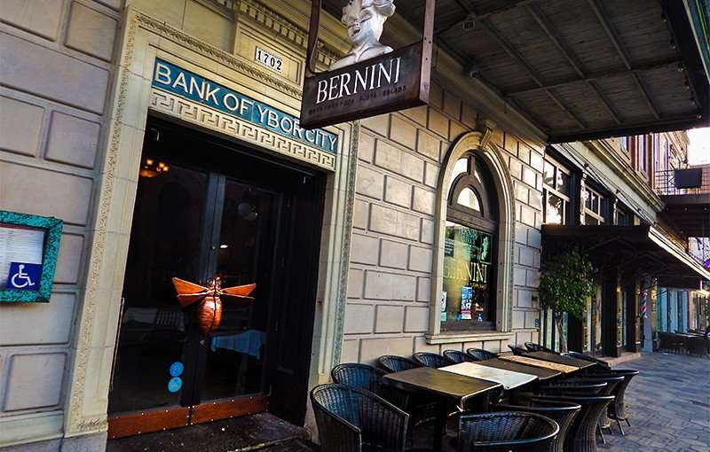 NOV 8, 2015 - Bernini Italian Restaurant in Bank Of Ybor City building embossed on front door entrance on 7th Ave, Ybor City Tampa, FL/photonews247.com