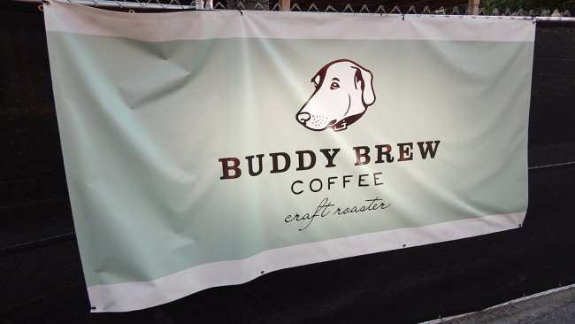 JULY 14, 2015 - Buddy Brew Coffee craft roasters on banner attatched to fence at construction in Hyde Park Village, Tampa, FL