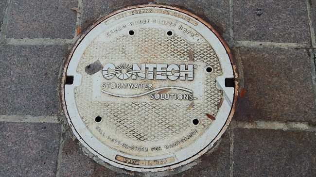 AUG 23, 2015 - Contech Storm water sewer lids on Tampa Riverwalk phone 1-877- 90-STORM/photonews247.com