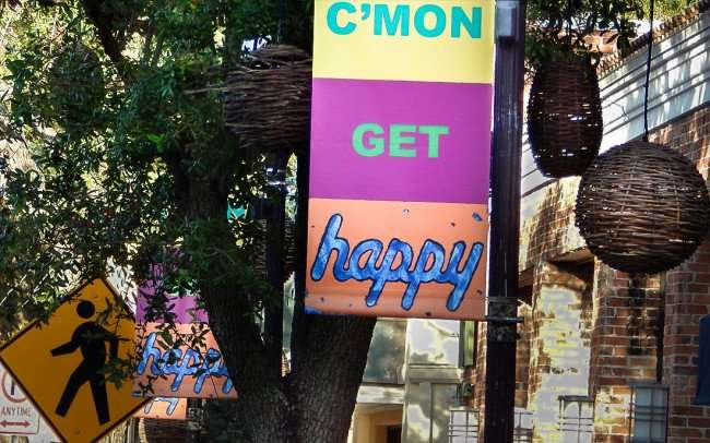 July 18, 2015 - Deborah Kass artwork C'MON GET HAPPY featured on banners in Hyde Park Village