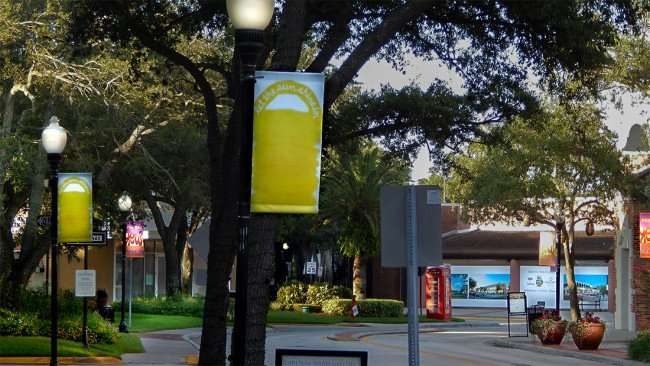 July 19, 2015 - Deborah Kass artwork LET THE SUN SHINE IN featured on banners in Hyde Park Village