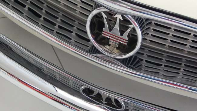 July 14, 2015 - Embossed emblem on grille of Masserati 3500 GT SuperLeggara parked in showroom at Ferrari of Tampa