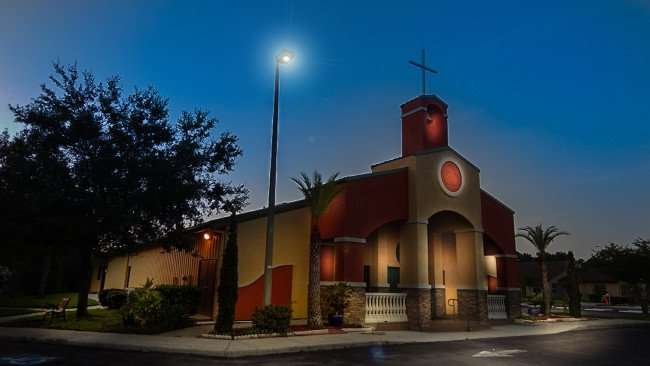 July 3, 2015 - Our Lady of Guadalupe Catholic Church with bell tower on US 301, Wimauma SouthShore, FL