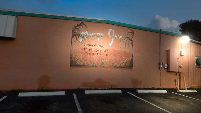 JULY 24, 2015 - MANGO JO'S South Shore bar with art work mural on building, 674 College Ave, Ruskin, FL/photonews247.com
